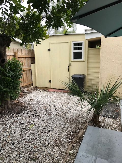 Florida Beach House Outdoor Storage Shed Yellow With A Window Crushed Shell Walkway Cottage Decor In 2018 Pinterest Cottages