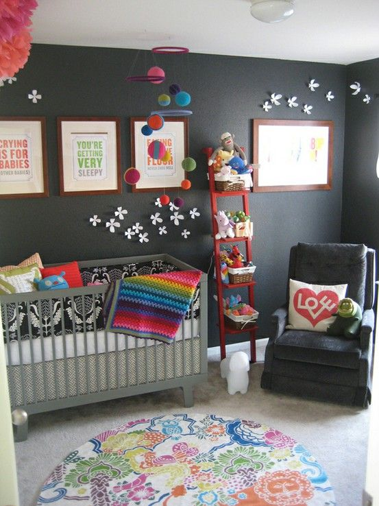 """Love this color scheme for a gender neutral nursery... could add more pinks and purples if baby is a girl or more greens and blues for a boy later! But I love the rainbow quilt  and cute pillows.  Perfect for a creative kiddo ... this is my style!  Love the art""""sy"""" vibe"""