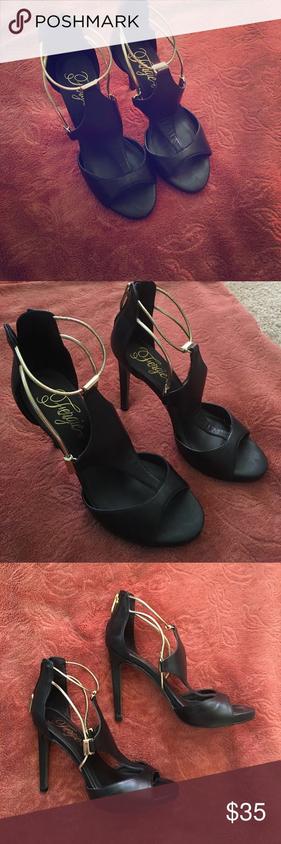 Black leather and gold Fergie heels size 7 Genuine black leather size 7 heels with lightly cushioned soles and gold straps with metal detailing. In good used condition, only worn once. Super comfy and stylish Fergie Shoes Heels