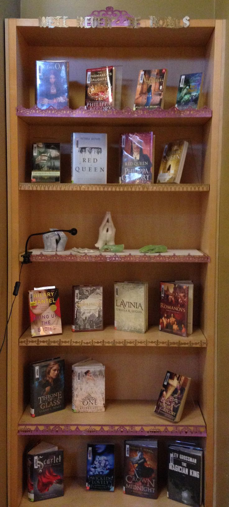We'll never be royals library display. High school library. fiction books  featuring