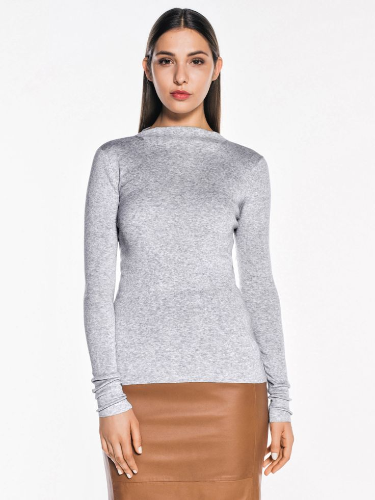 Made from a Pima cotton yarn, this fine rib knit features a small funnel neck with a jersey roll edge. This long sleeve style has a fitted silhouette.<br…