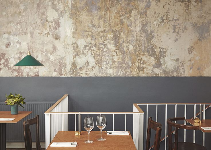 A complete interior renovation from Frama Interior Architecture. With leather detailed railings, white wainscotings, St. Pauls Blue Walls and concrete floors, the contrast between classic and raw is what dominates this bistro in the centre of Copenhagen.