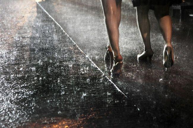 Two women in rain