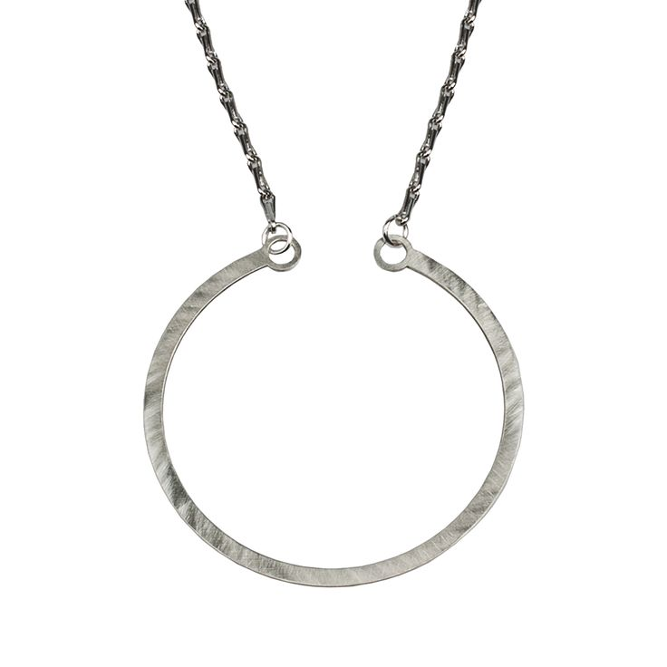 "Delicate circle pendant from NOILENCE's Luminous collection.  Materials: Chain-- Brass, Pendant-- Sterling silver  Measurements: Chain-- 37 cm (14.6"") on either side, Pendant-- 6 cm x 6 cm (2.4"" x 2.4"")  Designed in: Greece  Crafted in: Greece"