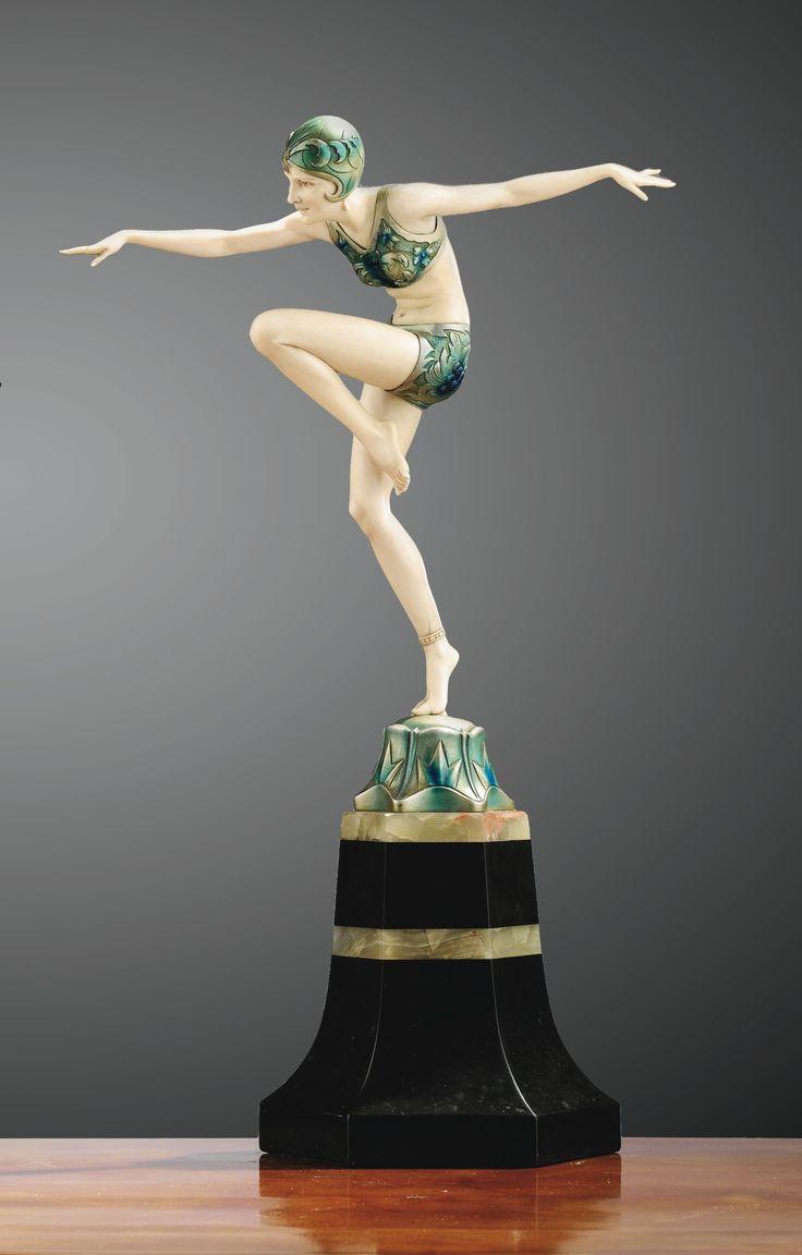 Ferdinand PREISS (1882-1943) 'Con Brio', vers 1925. 'CON BRIO', a bronze and ivory figure of a dancer, circa 1925, signed. Sculpture chryséléphantine en bronze patiné à froid et ivoire, pose sur une base en onyx. Signée F. Preiss sur la base. (hva)