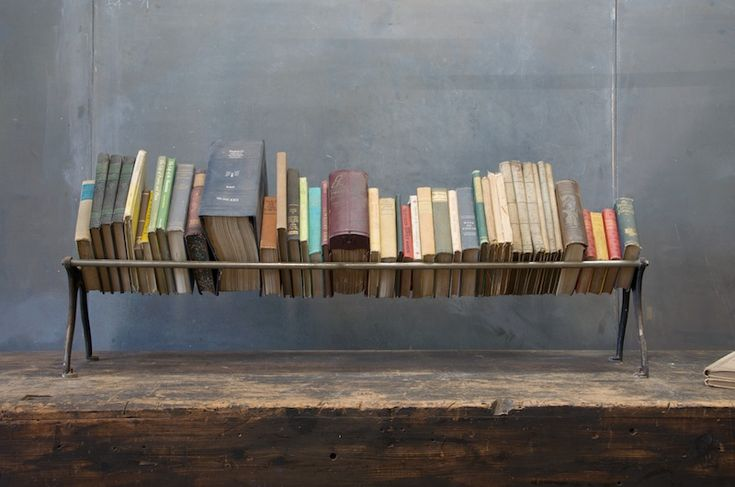 Beautiful way to display/store books near the floor without them touching the ground.