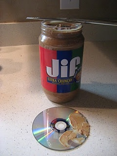 Peanut buttery fix for scratched DVDs. I just tried this on a DVD that was long gone, so I wasn't worried about it. Rubbed some peanutbutter on Doc McStuffins, buffed it all off with tissue and boom, played like a charm!