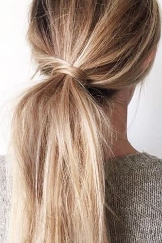 A low ponytail is our go-to look that is as chic as it is simple. If you want a little more though without the extra effort, consider updating your low ponytail with this simple and subtle twist!