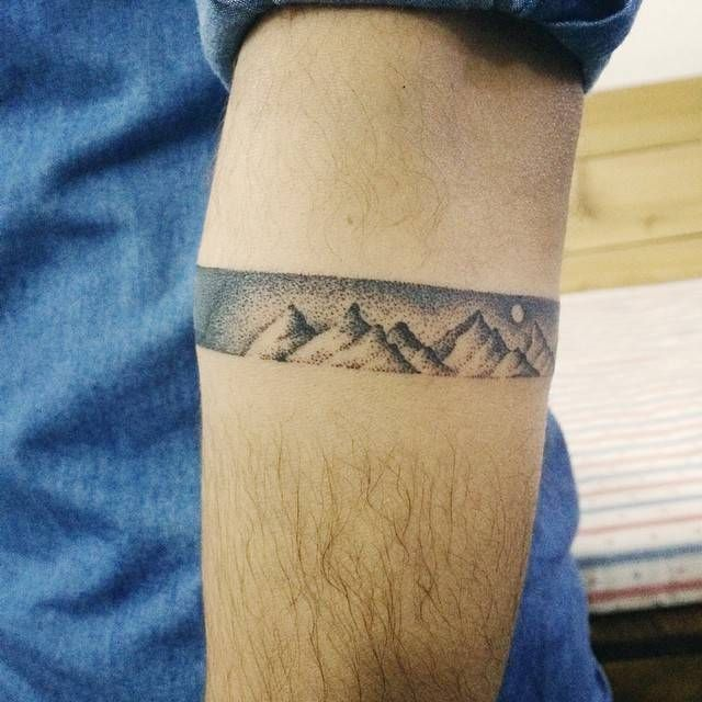 Dotwork style mountain armband. Tattoo artist: Doy - Little Tattoos for Men and Women