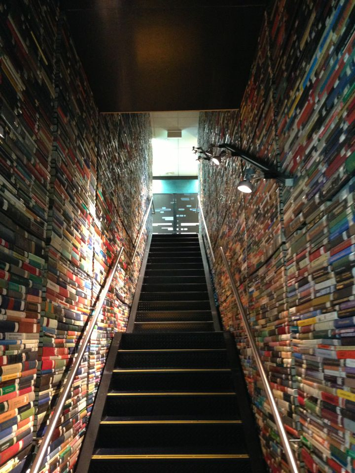 A mysterious and magnificent book-lined staircase. The photo may depict a staircase, at Australia's Deakin University Library,  .