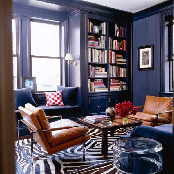 A darling blue library. I love the classic built-in window seat and bookshelves juxtaposed against the modern leather chairs.