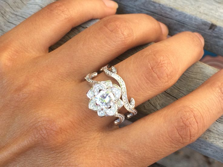 Round white CZ 925 sterling silver flower wedding band engagement ring sets! Women's beautiful petite 2 piece triple A grade cubic zirconia wedding set. Crafted from solid 925 sterling silver. The rin