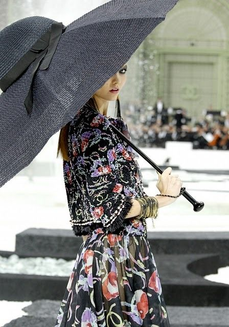 Chanel's umbrella hat, practical and oh-so stylish