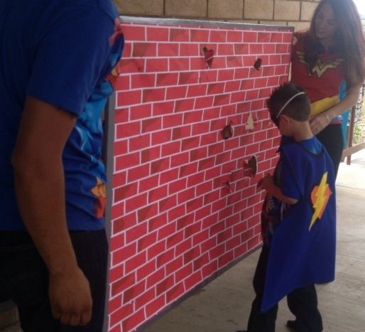 Superhero punchwall game. The kids LOVED this. Superheroes had to punch through the wall to get their prize. Superhero Birthday party. Capes mask Original idea: http://blog.celebratethebigandsmall.com/2011/08/10/856/