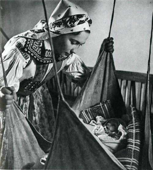 Mother beside the cradle. Javornik (Czech Republic, 20th century).