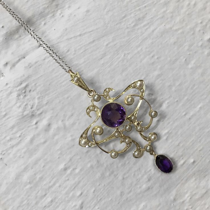A Vintage Amethyst & Seed Pearl necklace.
