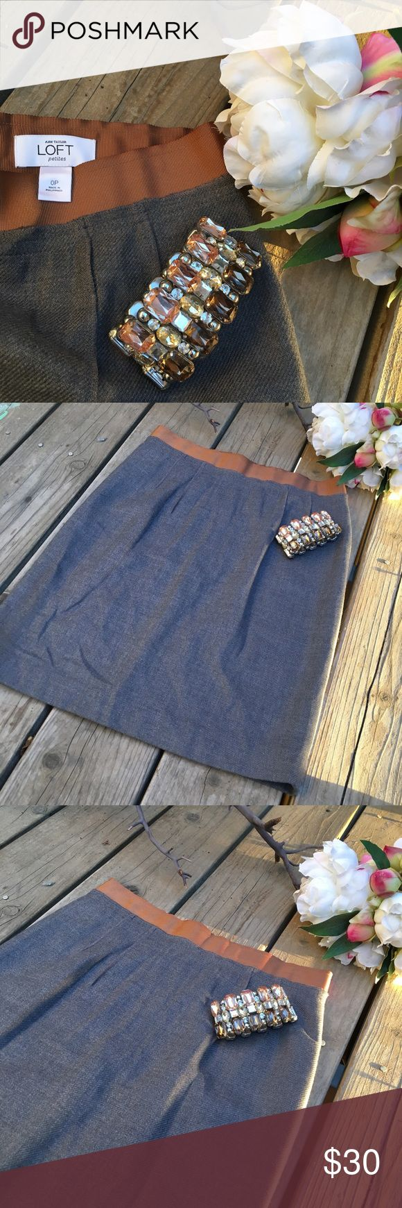 Beautiful Ann Taylor Loft Career Skirt🌸 🍂Beautiful Ann Taylor Loft Career Skirt, is gray in color and has a brown trim around the waistline and zipper. It's pleated from the front/back and has a lining underneath. Can be paired with anything! Perfect condition. New without Tags. Comes from a smoke-free home:)🍂🌸🍂 Ann Taylor Loft Skirts Midi