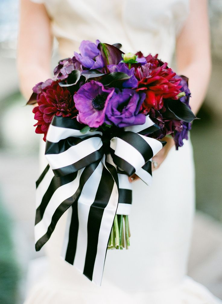 Bold bouquet with a graphic bow. Click to see more! | Photography : Taylor Lord Photography | Planning : Timeless Beginnings | Floral Design : DeVinnie's Paradise Read More on SMP: http://www.stylemepretty.com/2013/05/16/san-antonio-wedding-from-taylor-lord-photography/