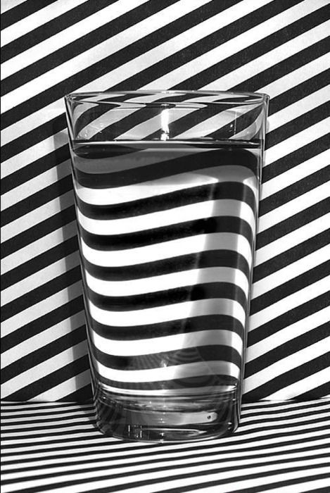 Glass.  Water.  Black and white stripes.