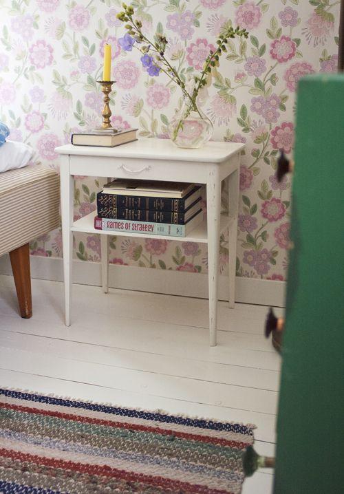 Bedroom. With vintage wallpaper, old furniture and wooden floors.  ennui.blogg.se
