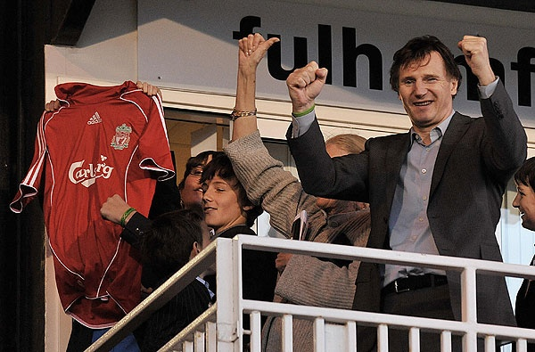 Liam Neeson and sons Michael and Daniel cheer on their beloved Liverpool FC at Craven Cottage, home of Fulham.