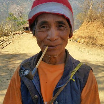 a portrait of An elderly Burmese man smoking a pipe #myanmar