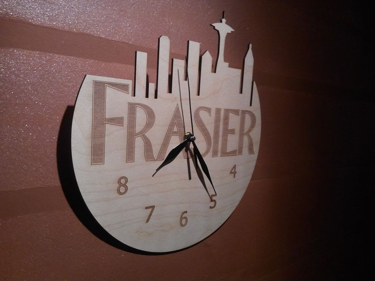wooden wall clock made by laser engraving
