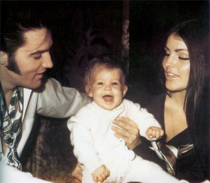 Elvis Presley with his wife Priscilla and Lisa Marie