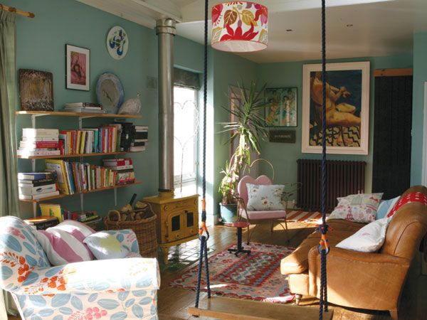 beautiful colourful living room area, it looks like a really comfy room, love it