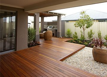 Timber flooring, over-sized pot plants, cream-coloured pebbles and the pergola! <3 <3 <3