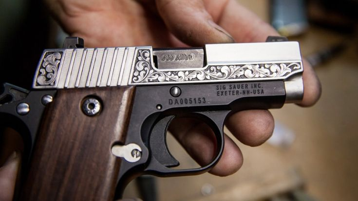 Layne Zuelke engraved his own Sig Sauer P238 pistol in high-relief scrollwork. Photo by Kim Ashford.
