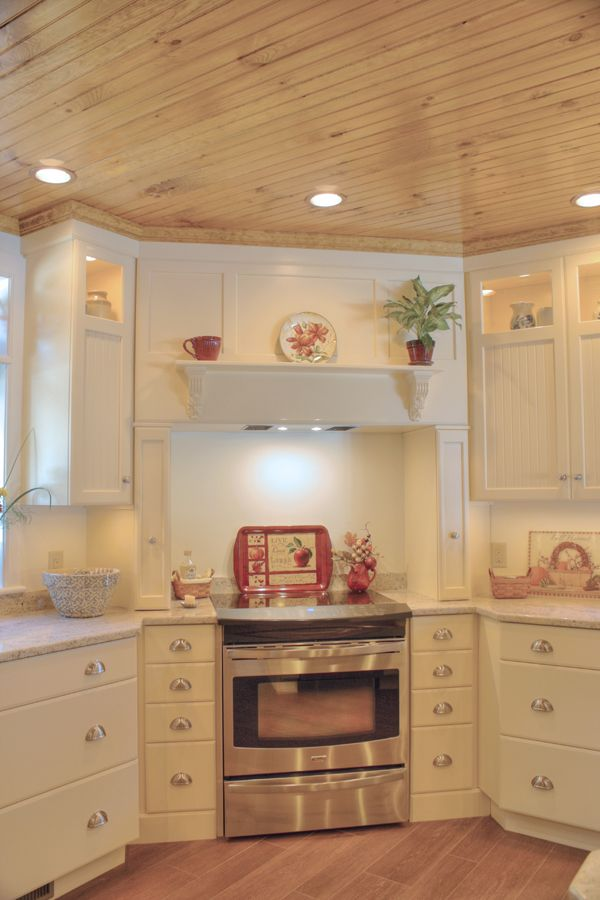 Paint Kitchen- stainless steel appliances, Mantle hood, custom wood turnings, deco glass cabinets, white full moon pained cabinets, granite countertops