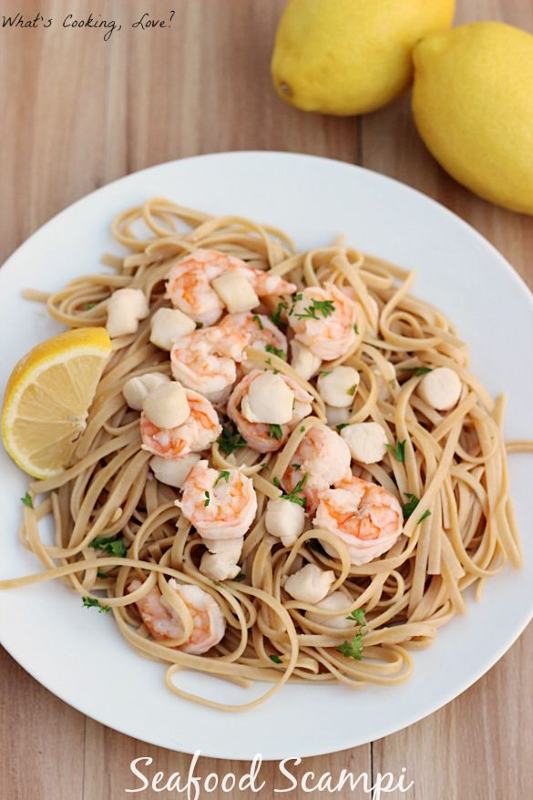 Seafood Scampi. Shrimp and scallops cooked in a white wine sauce and served over pasta. This makes a delicious and easy dinner. #seafood