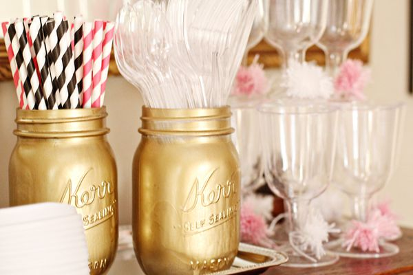 The gold trend:  Mason jars sprayed gold to hold utensils www.charmingincharlotte.blogspot.com