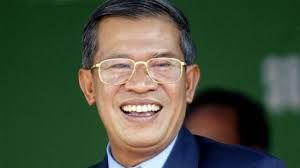 Government: This is Cambodia's Prime Minister Hun Sen. Hun Sen is one step down from King Norodom Sihamoni who is the Chief of State. Prime Minister Hun Sen has been in office since January 14, 1985.