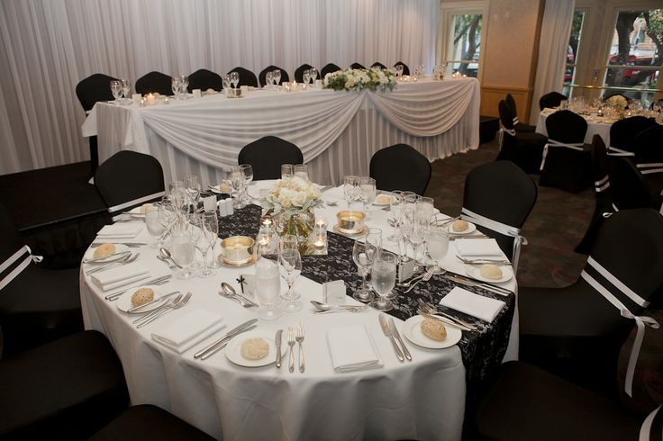 Black and white wedding reception. Black lace runners with white florals. Styled by Greenstone Events.