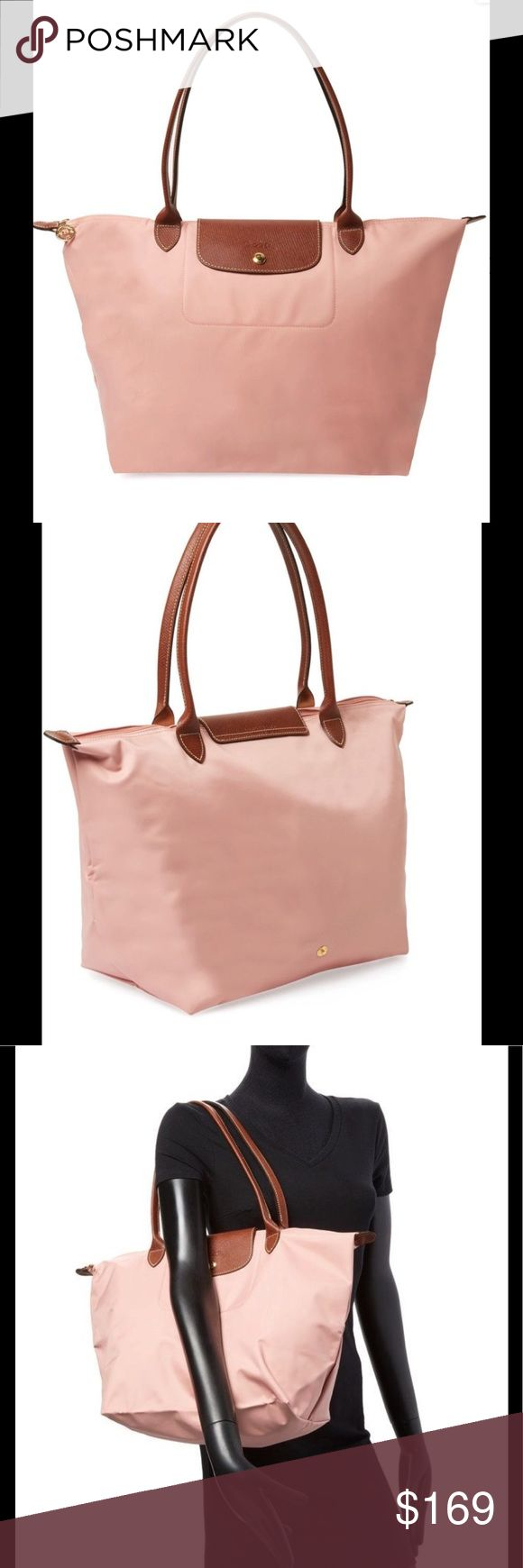 Authentic Longchamp Pinky Large Tote bag brand new with tags - Rare light pink color sold out everywhere- Price is firm! Longchamp Bags Shoulder Bags