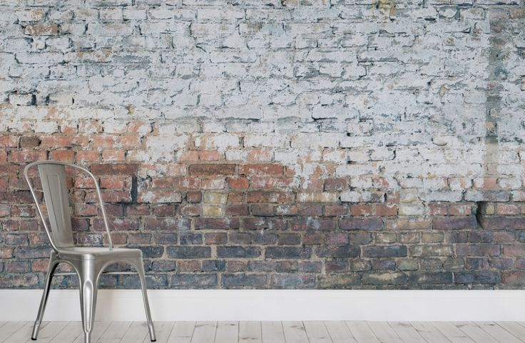This grunge brick effect wallpaper is awash with personality; the makeshift blocks and murky white glaze scream no to conformity and perfection. The rebellious punch of the mural's composition makes it the perfect backdrop for rockers and renegades. Partner the wallpaper with industrial decor - metals and woods will work best - for a lively and impactful grunge interior style.