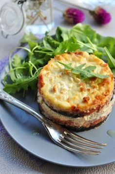 Moussaka - Greek dish made by layering eggplant with a spiced meat filling and topping it off with a creamy bechamel sauce.