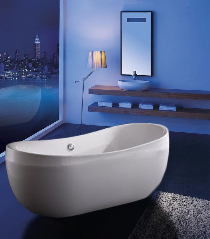 """The slim contour and clean lines of this white freestanding bathtub are perfect for a contemporary bathroom style. Crafted from acrylic, it is both durable and relatively light in weight when compared to other common bathtub materials. Nice and roomy at 69 inches long and 28 inches high, you can expect a serene escape as you submerge into this AKDY soaking tub..AKDY 69"""" Freestanding Soaking Bathtub AZ-F270"""
