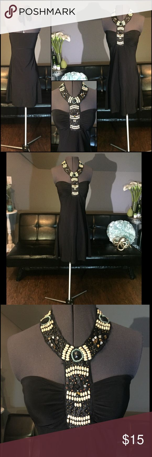 Black Fitted Stretch Tribal Beaded Chocker Dress Small  Great Condition  Material has stretch  Quality thicker material.  Bust Lining  Skirt has a slight flair towards bottom  Not thin or see through  Ties around neck to adjust fitting  Comfortable and easy to move in. Dresses Mini