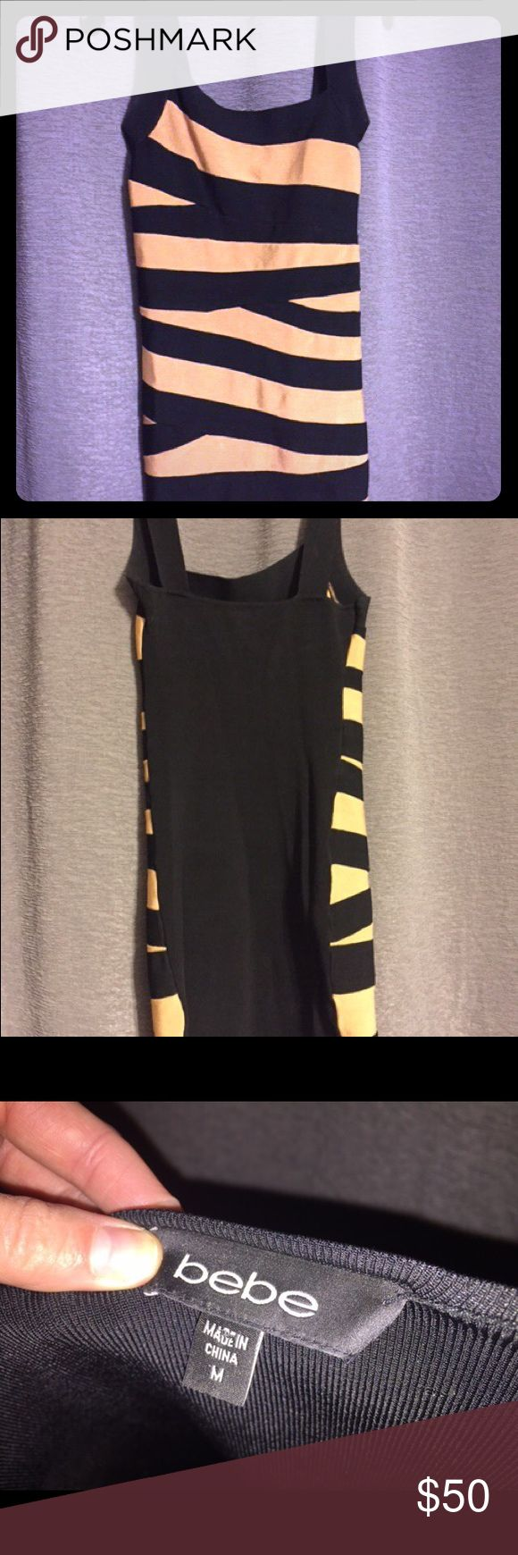 bebe Black and Gold Bandage Dress This dress is a blast to wear and looking for a new home. EUC all black back bandage dress. bebe Dresses Mini