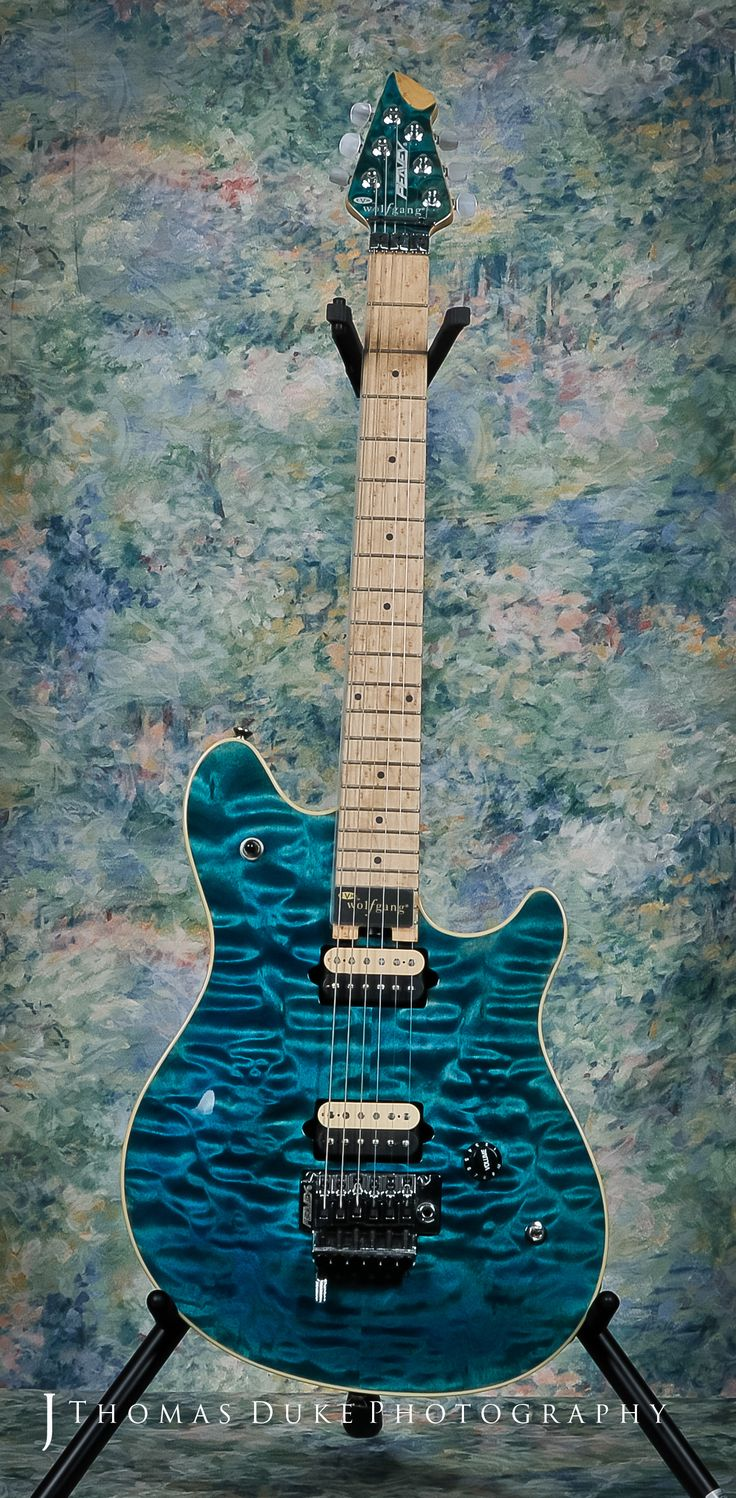 Peavey Wolfgang Custom Shop built in 2003. Quilt top, birdseye neck and headstock, single volume knob and coil tap.