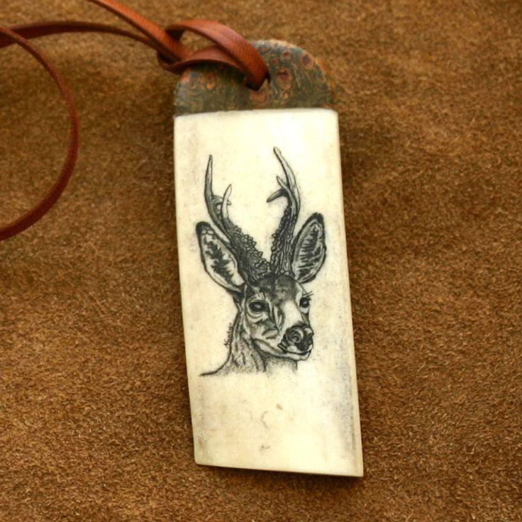 "Scrimshaw ""Roe deer"" Scrimshaw engraved roe deer on an antler piece, stabilized maple wood with vulcanized green fiber.  Kangaroo leather cord, clamps of german silver, closure of camel bone, stabilized maple wood tip with vulcanized fiber, whitetail deer and ram horn.  noemi rafel   Home #b2zone"