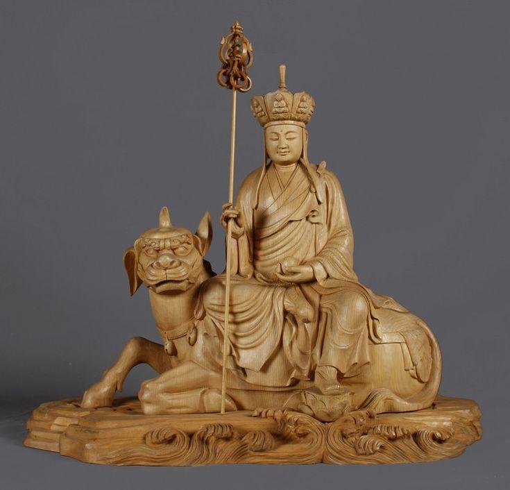 Деревянная статуэтка, изображающая богиню Гуаньинь верхом на драконе Хоу