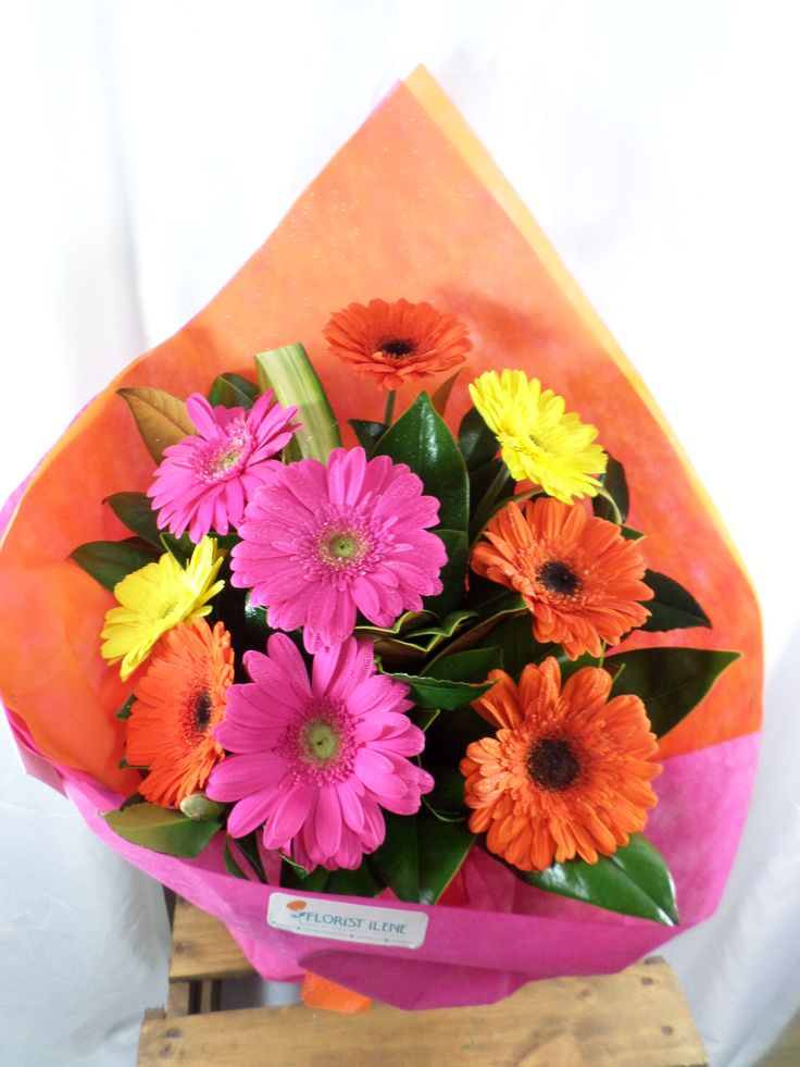 Bright and bold bouquet made with Gerbera's created by florist ilene
