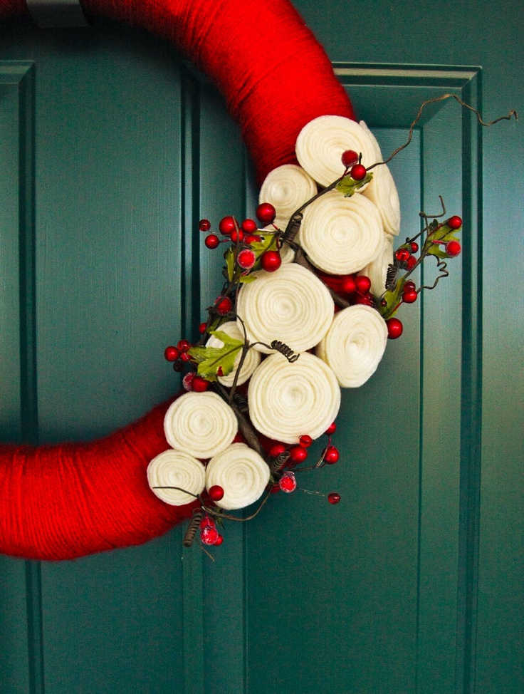 DIY yarn wreaths. Use any color and different flowers to fit your personal style!