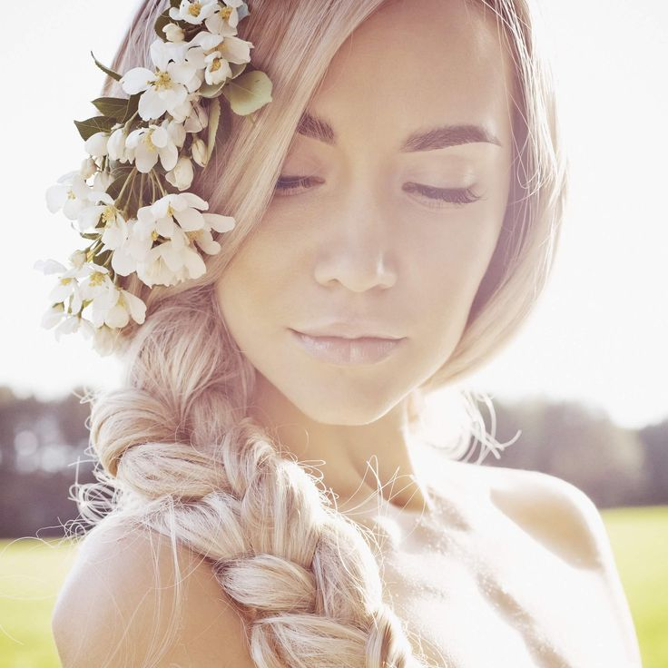 Blonde Woman With Flowers In Her Hair Beach Wedding Hairstyles