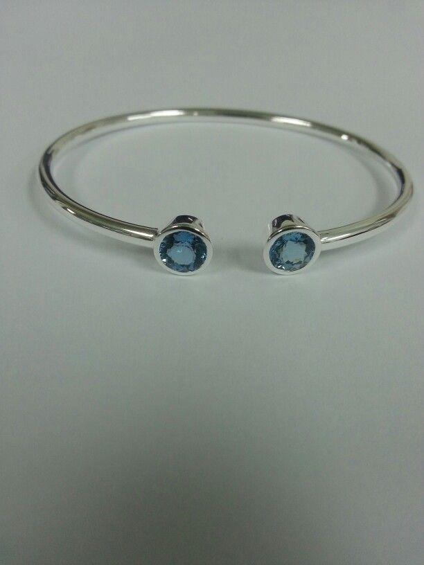 £ 56 Flexi silver bangle with 5mm round sky blue tanzanite.