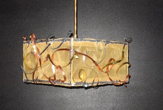 Handmade pendant lamp made of brass, copper, aluminum and brass net.
